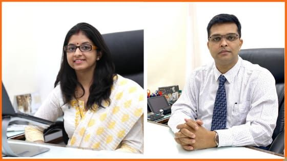 PaisaDukan Founders Rajiv M. Ranjan & Neeta Ranjan on their office desk