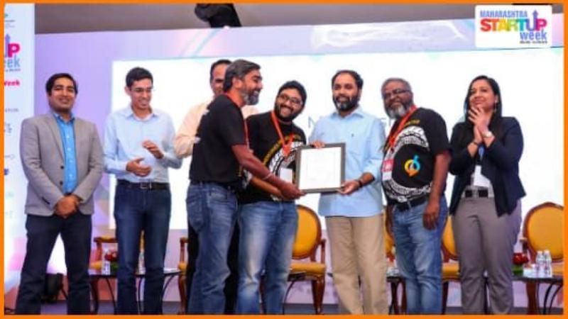 ScoutMyTrip Founders Receiving Award at Maharashtra Startup Week